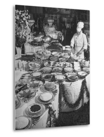 Chef Preparing Dish at Buffet Table in Dining Room of the Waldorf Astoria Hotel-Alfred Eisenstaedt-Metal Print