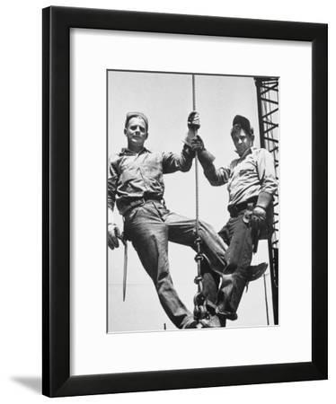 Construction Workers Standing on a Wreaking Ball-Ralph Crane-Framed Photographic Print