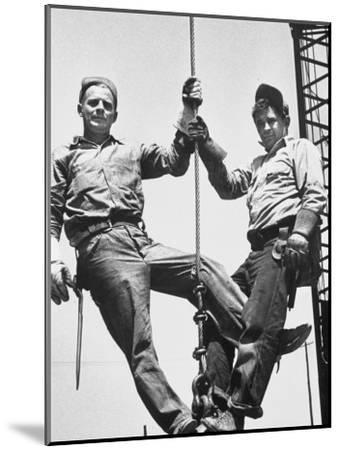 Construction Workers Standing on a Wreaking Ball-Ralph Crane-Mounted Photographic Print