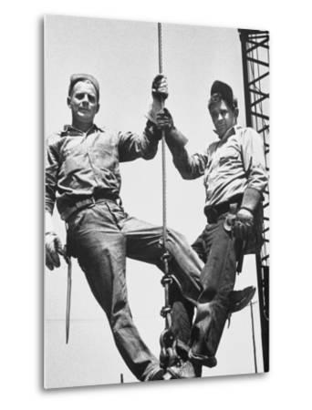 Construction Workers Standing on a Wreaking Ball-Ralph Crane-Metal Print