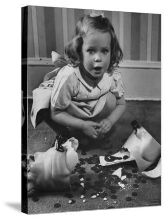 Little Girl Leaning over Her Broken Piggy Bank-Nina Leen-Stretched Canvas Print