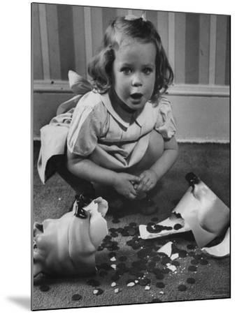 Little Girl Leaning over Her Broken Piggy Bank-Nina Leen-Mounted Photographic Print