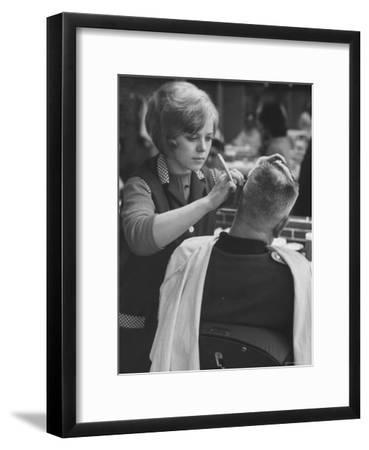 Female Barber Cutting a Customer's Hair in a Barber Shop-Ralph Crane-Framed Photographic Print