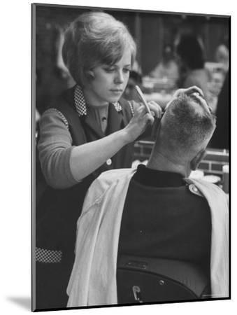 Female Barber Cutting a Customer's Hair in a Barber Shop-Ralph Crane-Mounted Photographic Print
