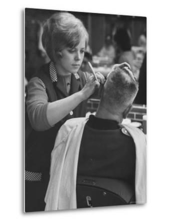 Female Barber Cutting a Customer's Hair in a Barber Shop-Ralph Crane-Metal Print