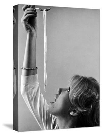 Hayley Mills Attempting to Eat Spaghetti-Ralph Crane-Stretched Canvas Print