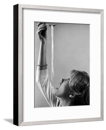 Hayley Mills Attempting to Eat Spaghetti-Ralph Crane-Framed Photographic Print