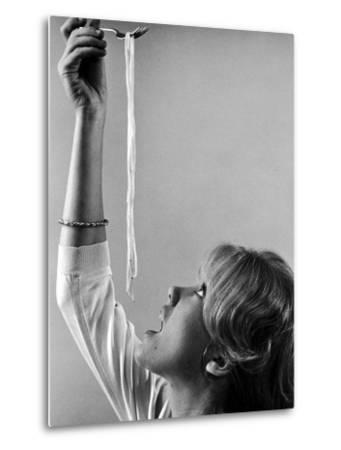 Hayley Mills Attempting to Eat Spaghetti-Ralph Crane-Metal Print