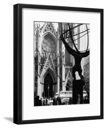 Entrance to St. Patrick's Visible Across Fifth Avenue, with Atlas Statue Silhouetted in Foreground-Andreas Feininger-Framed Photographic Print