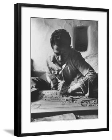 Greek Mountain Villager Engaged in Woodworking During the Winter-James Burke-Framed Photographic Print
