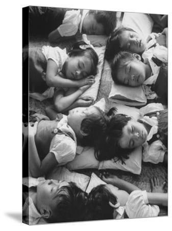 Kindergarten Students at the Yumin Chinese School Laying Head to Head During Nap Time-Howard Sochurek-Stretched Canvas Print