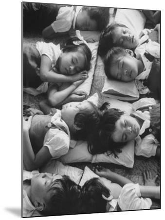 Kindergarten Students at the Yumin Chinese School Laying Head to Head During Nap Time-Howard Sochurek-Mounted Photographic Print