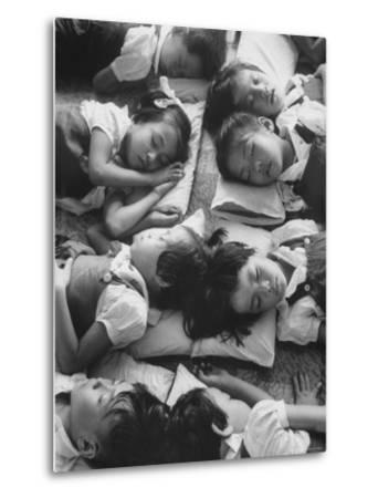 Kindergarten Students at the Yumin Chinese School Laying Head to Head During Nap Time-Howard Sochurek-Metal Print