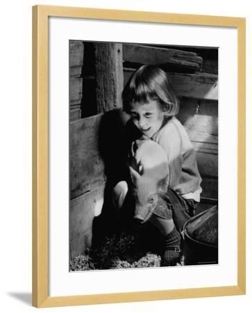Jan Bruene with Piglet of a Group 2-3 Weeks Old, Kept in Basement of Home-Gordon Parks-Framed Photographic Print