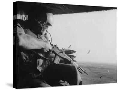 US Military Personnel Firing from Helicopters Onto Viet Cong Targets-Larry Burrows-Stretched Canvas Print