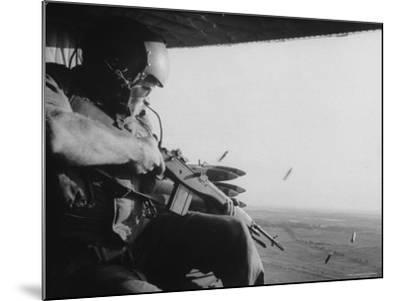 US Military Personnel Firing from Helicopters Onto Viet Cong Targets-Larry Burrows-Mounted Photographic Print