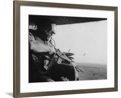 US Military Personnel Firing from Helicopters Onto Viet Cong Targets-Larry Burrows-Framed Photographic Print