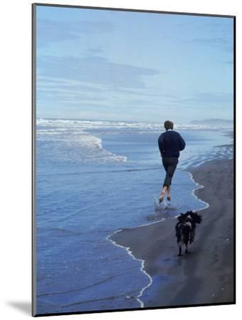 Presidential Candidate Bobby Kennedy and His Dog, Freckles, Running on an Oregon Beach-Bill Eppridge-Mounted Photographic Print