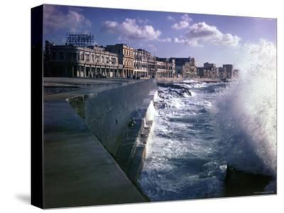 Wave Crashing Against a Breakwater Along the Malecon, a Waterfront Boulevard-Eliot Elisofon-Stretched Canvas Print