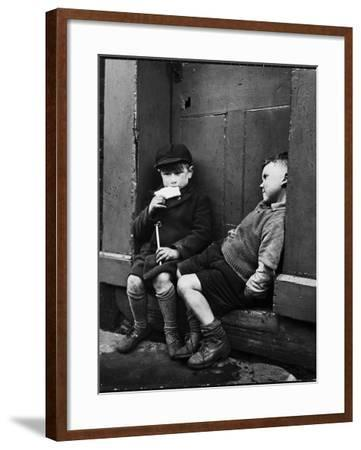 Two Boys Sitting on Doorstep-Nat Farbman-Framed Photographic Print