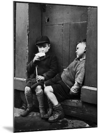 Two Boys Sitting on Doorstep-Nat Farbman-Mounted Photographic Print