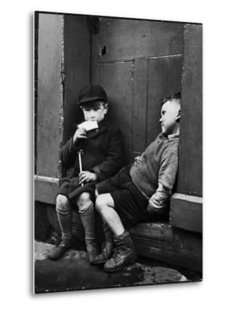 Two Boys Sitting on Doorstep-Nat Farbman-Metal Print