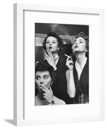 Models Exhaling Elegantly, Learning Proper Cigarette Smoking Technique in Practice For TV Ad-Peter Stackpole-Framed Photographic Print