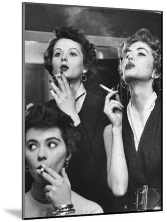Models Exhaling Elegantly, Learning Proper Cigarette Smoking Technique in Practice For TV Ad-Peter Stackpole-Mounted Photographic Print