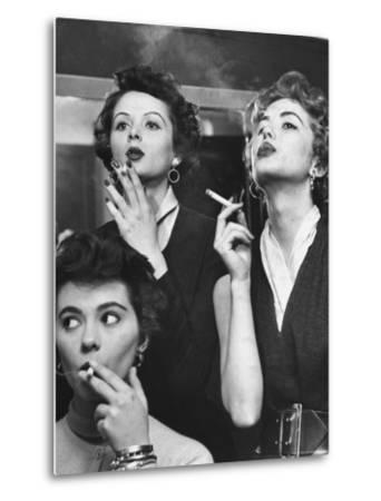 Models Exhaling Elegantly, Learning Proper Cigarette Smoking Technique in Practice For TV Ad-Peter Stackpole-Metal Print