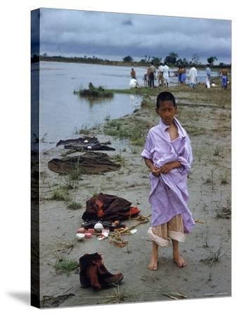 Tibetan Refugees on Beach at Misamari Camp-John Dominis-Stretched Canvas Print