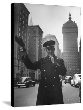 Park Avenue Doorman Using Whistle to Flag Down a Taxi For One of the Residents of His Building-William C^ Shrout-Stretched Canvas Print
