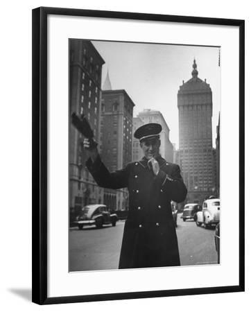 Park Avenue Doorman Using Whistle to Flag Down a Taxi For One of the Residents of His Building-William C^ Shrout-Framed Photographic Print