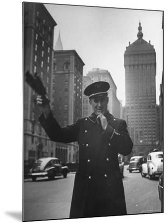 Park Avenue Doorman Using Whistle to Flag Down a Taxi For One of the Residents of His Building-William C^ Shrout-Mounted Photographic Print