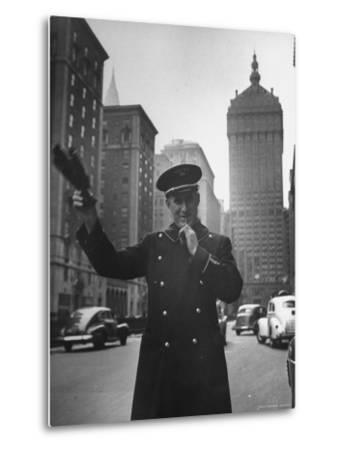 Park Avenue Doorman Using Whistle to Flag Down a Taxi For One of the Residents of His Building-William C^ Shrout-Metal Print