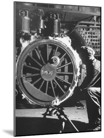 Welder with an Acetylene Torch Cutting Through Some of the Old Tubes in a Modern Locomotive-Thomas D^ Mcavoy-Mounted Photographic Print