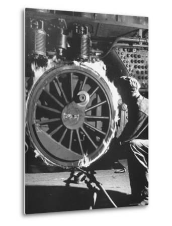 Welder with an Acetylene Torch Cutting Through Some of the Old Tubes in a Modern Locomotive-Thomas D^ Mcavoy-Metal Print