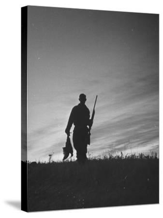 Pheasant Hunter Carrying Bird That He Killed-Wallace Kirkland-Stretched Canvas Print
