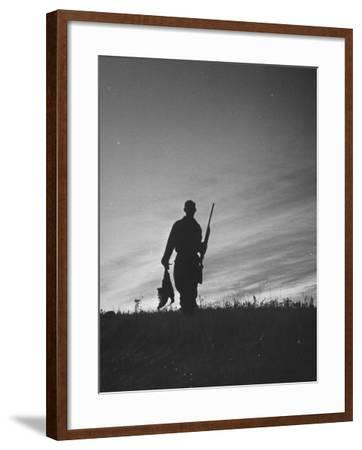Pheasant Hunter Carrying Bird That He Killed-Wallace Kirkland-Framed Photographic Print