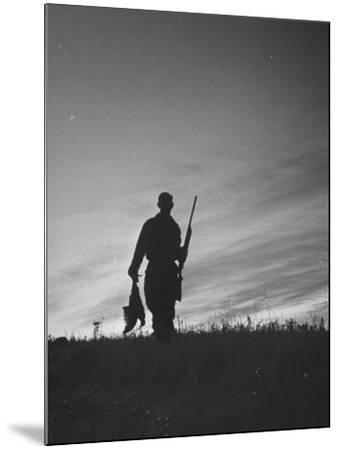 Pheasant Hunter Carrying Bird That He Killed-Wallace Kirkland-Mounted Photographic Print