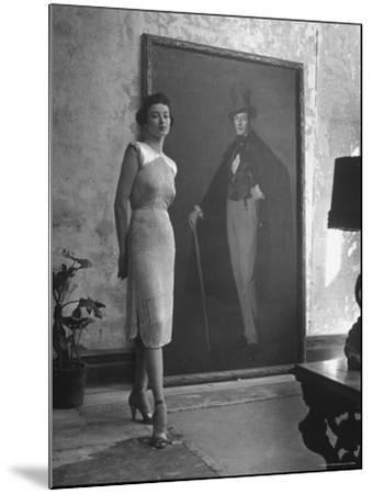 View of a Harper and Vogue Model in Designer Clothes-Nina Leen-Mounted Photographic Print