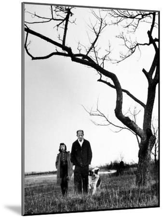 Painter Jackson Pollock Walking in Field with Wife Lee Krasner-Martha Holmes-Mounted Photographic Print
