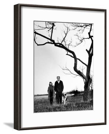Painter Jackson Pollock Walking in Field with Wife Lee Krasner-Martha Holmes-Framed Photographic Print