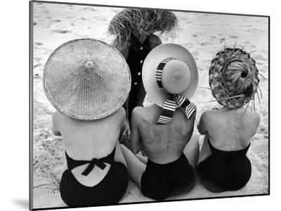 Models on Beach Wearing Different Designs of Straw Hats-Nina Leen-Mounted Photographic Print