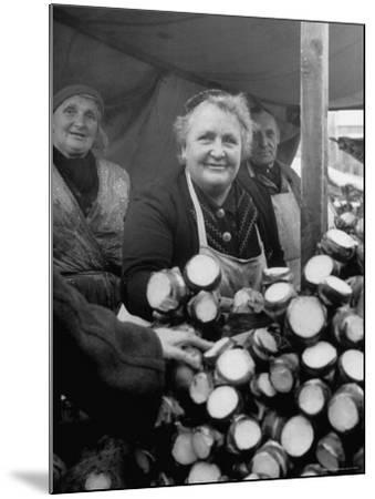 Woman Selling Vegetables at an Open Air Market Stall-Nina Leen-Mounted Photographic Print