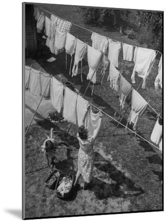 Mother Hanging Laundry Outdoors During Washday-Alfred Eisenstaedt-Mounted Photographic Print