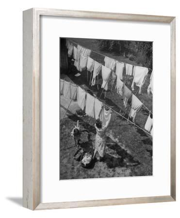 Mother Hanging Laundry Outdoors During Washday-Alfred Eisenstaedt-Framed Photographic Print