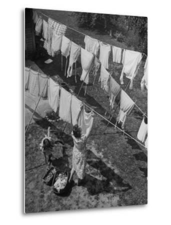 Mother Hanging Laundry Outdoors During Washday-Alfred Eisenstaedt-Metal Print