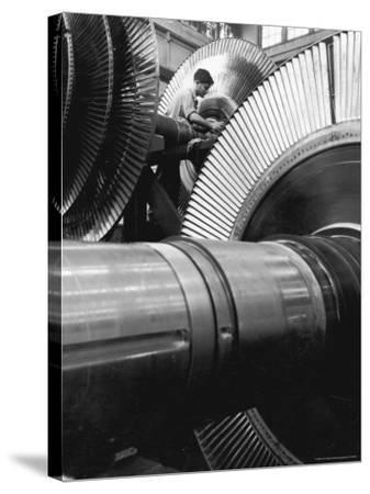 Workman on Large Wheel That Looks Like Fan, at General Electric Laboratory-Alfred Eisenstaedt-Stretched Canvas Print