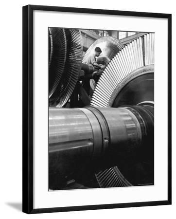 Workman on Large Wheel That Looks Like Fan, at General Electric Laboratory-Alfred Eisenstaedt-Framed Photographic Print