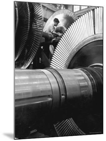 Workman on Large Wheel That Looks Like Fan, at General Electric Laboratory-Alfred Eisenstaedt-Mounted Photographic Print